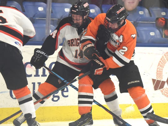 Spencer Gehres (left) tries to keep Northville's Nick