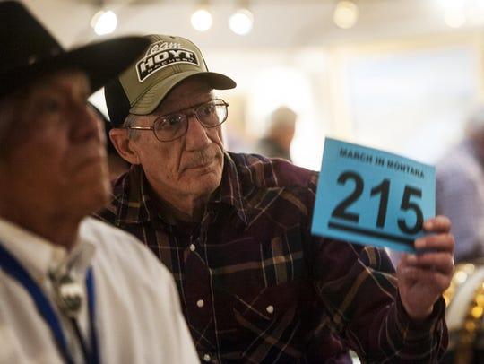 "Dan Rowland shows his bid number after purchasing ""Las"