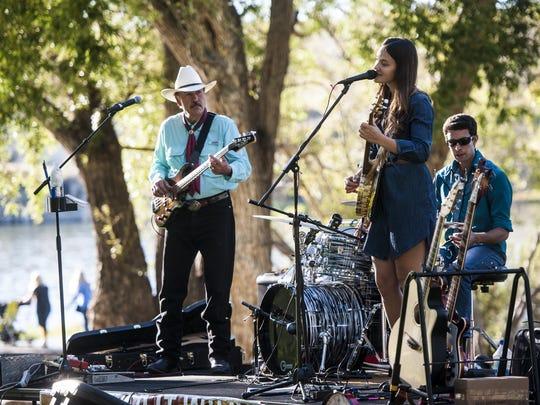 Rob and Halladay Quist perform with Valley Lopez during Wild Fest at Giant Springs State Park on Friday evening.