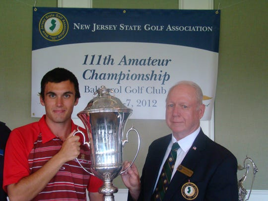 Ryan McCormick poses with the trophy after winning the 2012 NJSGA Amateur championship.