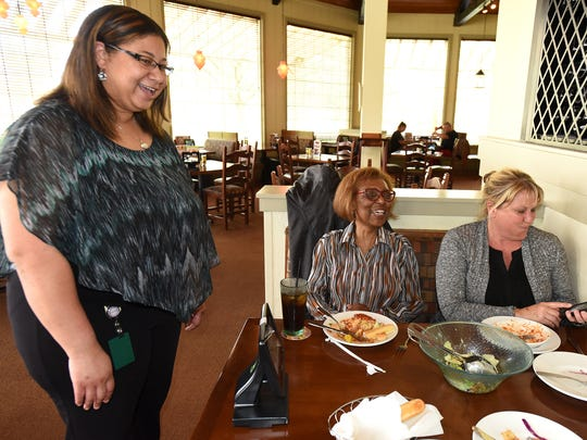 Livonia Olive Garden general manager Danielle Cleary stops by to chat with customers, including Patricia Johnson and Barbara Bovia, right, during their April 27 lunch at the restaurant on Middlebelt north of I-96. Cleary has worked her way up to a management spot since she began as a hostess at age 16.