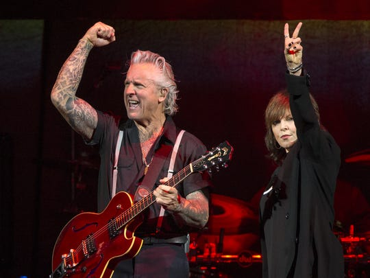 Pat Benatar performs on stage with her husband, guitarist