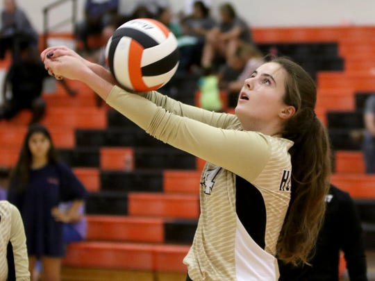 Henrietta's Brooklyn McMurry hits the ball back over to Boyd Saturday, Aug. 12, 2017, at the Cool in Boomtown tounament in Burkburnett.