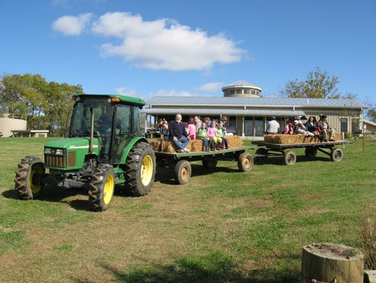 """Past hayride at the annual """"Farm Day"""" that has become"""