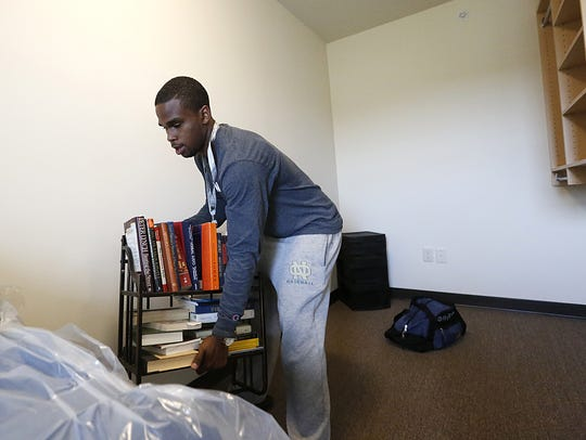 John Stroud of Fond du Lac moves into the new student