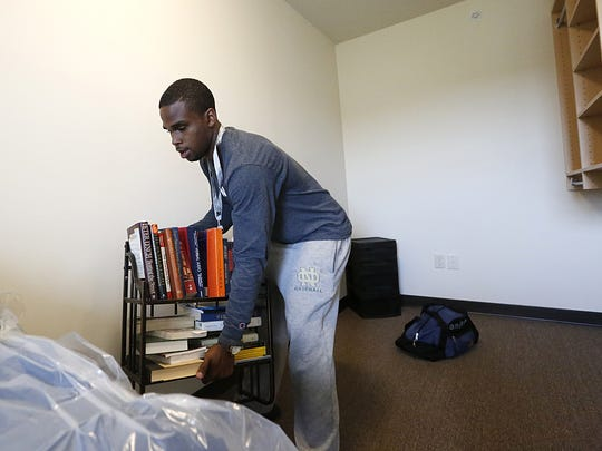 John Stroud of Fond du Lac moves into the new student housing building Monday on the University of Fond du Lac campus. Stroud is attending the UW Fond du Lac majoring in economics.