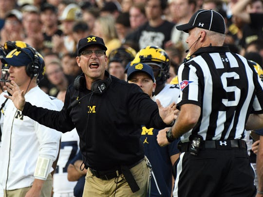Michigan coach Jim Harbaugh reacts on the sidelines as Purdue goes down to Michigan 28-10 in West Lafayette on Saturday September 23, 2017.