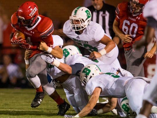 Luverne's Ellian Harris (4) is tackled by Brantley defenders at Luverne High School in Luverne, Ala. on Friday September 29, 2017.