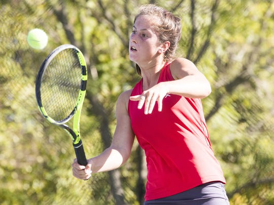 Vineland's Tess Fisher returns a shot during her win