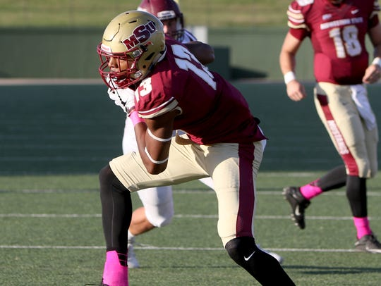 Midwestern State's Xavier Land catches the pass in