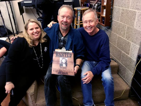 Don Schlitz, center, enjoys a moment with Room in the Inn founder Charlie Strobel, right and CEO Rachel Hester after the surprise celebration Monday! Oct. 23, 2017.