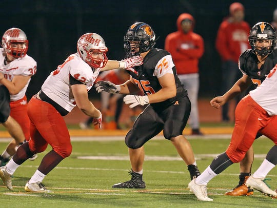 Anderson offensive lineman Zeke Correll sets up for