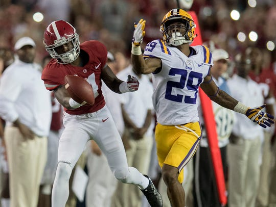 LSU cornerback Greedy Williams breaks up a pass intended