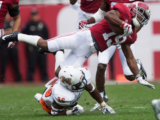 Alabama wide receiver Xavian Marks (19) is upended by Mercer defensive back BJ Bohler (26) in first half action at Bryant Denny Stadium in Tuscaloosa, Ala. on Saturday November 18, 2017. (Mickey Welsh / Montgomery Advertiser)