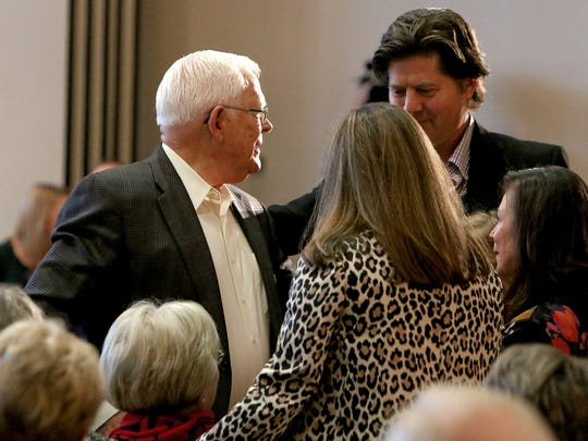 Al Guinn, left, is greeted by family after being named the Wichitan of the Year Tuesday afternoon at the Wichita Falls Country Club.