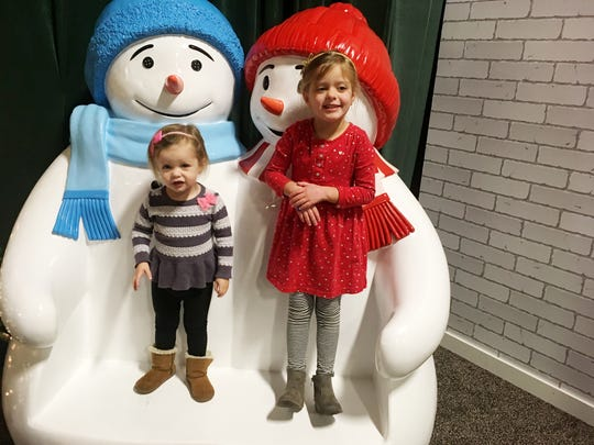 Ms. Cheap's grandaughters Maddie and Brinkley Miller enjoy some of the Gaylord Opryland Resort 's holiday snowmen.