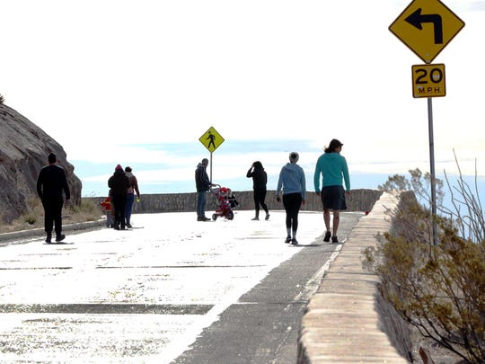 Walkers ascend the western side of Scenic Drive. The road is closed to motorized vehicles during Scenic Sundays from 7 to 11 a.m., opening the roadway to walkers, runners, cyclists and skaters.