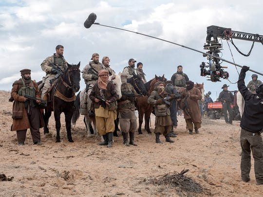 Chris Hemsworth, left on horse, during the filming
