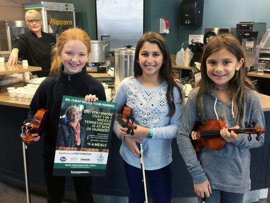 University School of Nashville's Fifth Grade Community Service Group raised $275 for Second Harvest. Lilly Martin, left, Ellie Rothman and Aliya Grossman played holiday music as part of the fundraiser.
