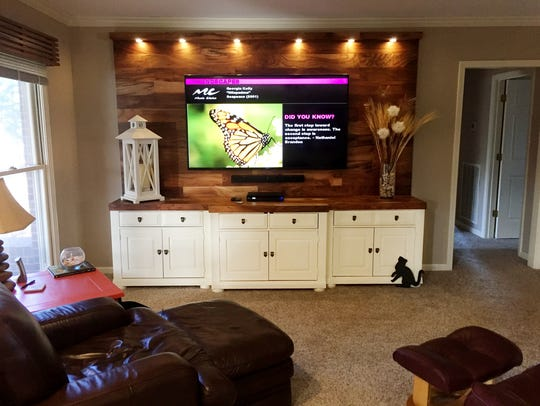 "This is the ""after"" view  of Kenny Peek's entertainment center conversion, a nine foot cabinet with the 70 inch TV mounted above on a backdrop he created using fiber board and a vinyl laminate."