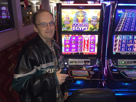 Raymond Johnston wears his Eagles coat proudly as he hoped to turn a little bit of Philadelphia's luck into his own playing the slots at Dover Downs.