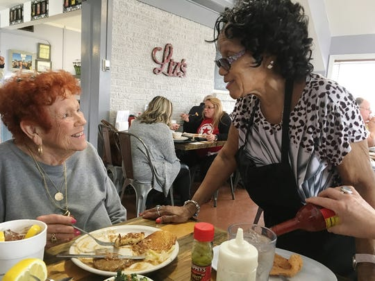 Liz's Meat-n-3 Kitchen: Liz's owner Liz Darden, right, visits with retired Judge Barbara Haynes at a recent lunch.