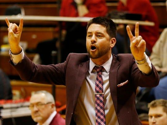 McCutcheon head coach Tyler Scherer shouts instructions