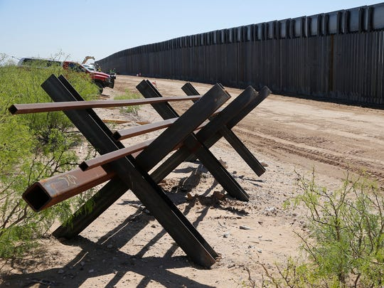 "A new $73 million bollard wall along a 20-mile portion of the U.S.-Mexico border will replace existing fencing in the Santa Teresa, N.M., area. The construction replaces existing posts that serve as vehicle barriers in the area. The wall will stand 18 feet to 30 feet tall in different areas, depending on the terrain. ""It is going help maintain a secure border. It is going to establish the operational control that the president has mandated,"" El Paso Border Patrol Sector Chief Aaron Hull said when construction was officially announced."