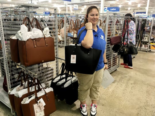 Gabe's manager Jodie Plymesser shows off a $295 Ivanka Trump handbag that her store sells for $49.99.