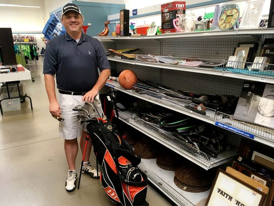Goodwill stores have assorted sporting goods, often including golf clubs and bags.