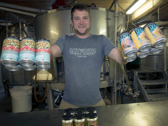 Ryan Richards, co-owner, displays the newly offered cans of beer on Wednesday, June 27, 2018 at Roy Pitz Brewing Company, Chambersburg.