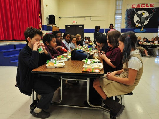 Students at Greenwood Elementary School in Princess Anne eat lunch in this 2010 file photo.