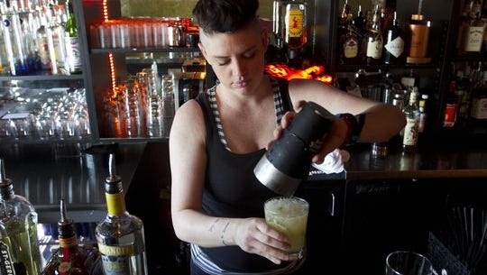 Brittany Bowman makes a White Sangria at Nevermind in Cape Coral. Nevermind Owner Shannon Yates spoke in favor of the city extending bar hours, which council approved in March.