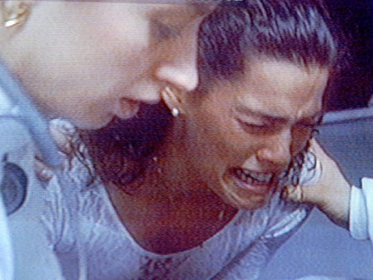U.S. Figure skating champion Nancy Kerrigan grimaces in pain after an unidentified man attacked her with a blunt instrument following a practice Jan. 6, 1994, at Cobo Arena in Detroit.