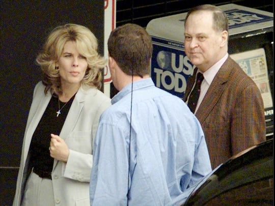 ADVANCE FOR SUNDAY, AUG. 24 AND THEREAFTER - This photo taken April 7, 1998 shows Frederick Koch, right, along with his sister-in-law Angela Koch, left, talking to the driver of their car before entering the federal courthouse in Topeka,  Kansas. The two were arriving for the second day of jury  selection in the trial that has divided the Koch family in two. Bill and  Frederick Koch are suing their brothers Charles and David for more than a  billion dollars. They?re demonized by Democrats, who lack a liberal equal to counter their weight, and not entirely understood by Republicans, who benefit from their seemingly limitless donations.