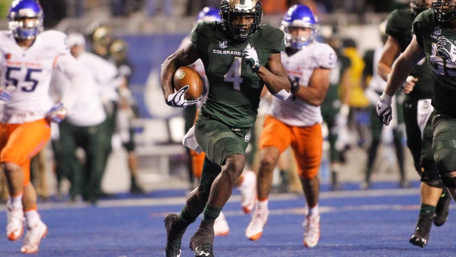 CSU receiver Michael Gallup runs away from Boise State defenders after making a catch Saturday night in the Rams' 28-23 loss at Boise State.