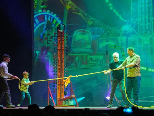 """""""MythBusters"""" hosts Jamie Hyneman, left, and Adam Savage, second from right, have adapted their Discovery Channel series for an interactive live tour, which visits Ames on Monday."""