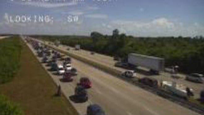 Traffic cameras show I-95 at a standstill after a motorcycle crash near Viera Sunday afternoon.