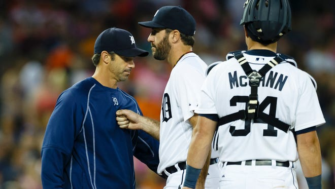 Tigers manager Brad Ausmus takes the ball to relieve pitcher Justin Verlander in the ninth inning of the Tigers' 5-4 win over the Royals in 12 innings Friday at Comerica Park.