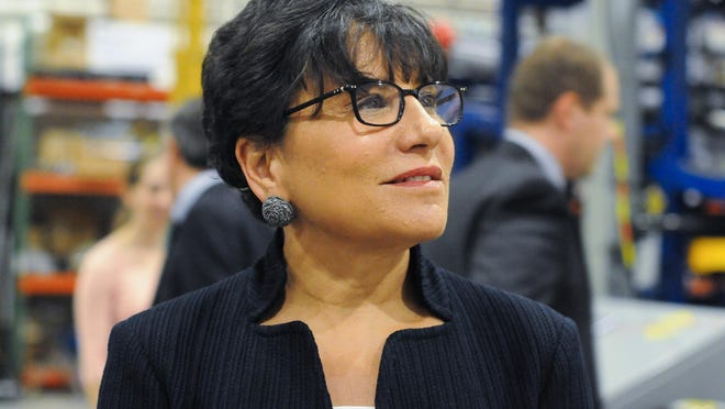 U.S. Commerce Secretary Penny Pritzker smiles as she watches machines at work while touring Accudyne Systems near Glasgow for National Manufacturing Day on Friday.