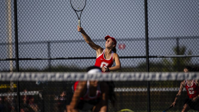 Glenwood's Amber Ehrlich sets up a serve during doubles play against Hillsboro at Glenwood High School, Friday, September 25, 2020, in Chatham, Ill.