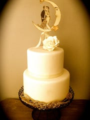 Illustrator and designer Kris Shoemaker made a 1920s-style paper embellishment as a cake topper.
