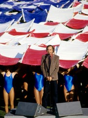 Super Bowl XXI: Musical artist Neil Diamond performs the National Anthem prior to Super XXI between the New York Giants and the Denver Broncos at the Rose Bowl. The Giants defeated the Broncos 39-20. The halftime theme, a Salute to Hollywood's 100th Anniversary-The World of Make Believe, featured George Burns, Mickey Rooney, Grambling State University and USC marching bands, more Disney characters and Southern California-area high school drill teams and dancers.