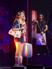 "Palm Desert-native Carrie St. Louis is seen here in ""Rock of Ages""  She begins playing Glinda, the lead role in ""Wicked,"" on Broadway Feb. 2."