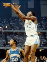 Mar 29, 1982; New Orleans, LA, USA; FILE PHOTO; North Carolina Tar Heels guard Michael Jordan (23) in action against Georgetown Hoyas forward Eric Smith (32) during the 1982 Final Four Championship game at the Superdome. The Tar Heels defeated the Hoyas 63-62. Mandatory Credit: Malcolm Emmons-USA TODAY Sports