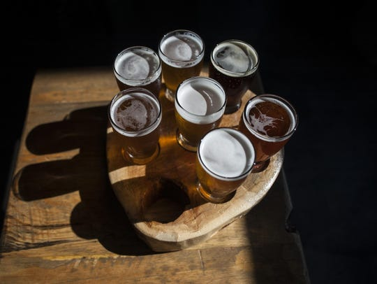 A flight at Great Burn Brewing uses a log round. The