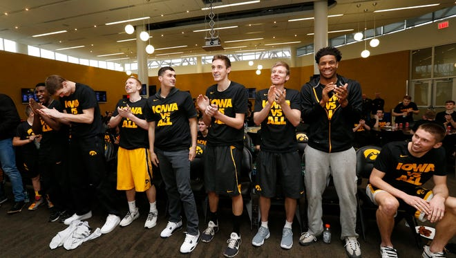 The Iowa Hawkeyes react as their name is called during the NCAA Tournament Selection Show Sunday on March 13 at Carver-Hawkeye Arena. Seventh-seeded Iowa plays No. 10 Temple on Friday in Brooklyn, New York.