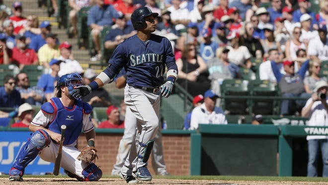 Seattle Mariners Robinson Cano (22) watches as his hit goes for a two-run home run during the ninth inning of a baseball game against the Texas Rangers Wednesday, April 6, 2016, in Arlington, Texas.