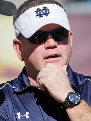 Notre Dame football coach Brian Kelly watches his team warm up before a game against Arizona State on Nov. 8, 2014, in Tempe, Ariz.