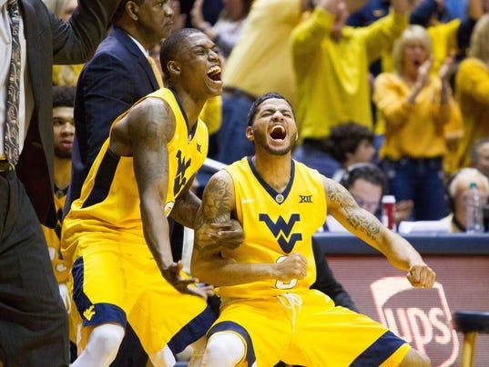 No. 18 West Virginia upsets No. 1 Kansas at home